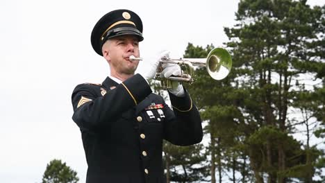 An-American-Soldier-Holds-A-Bugle-Up-To-His-Mouth-But-Does-Not-Play-At-The-Graveyard-Near-Normandy-Beach-75Th-Anniversary-Of-Dday-2019