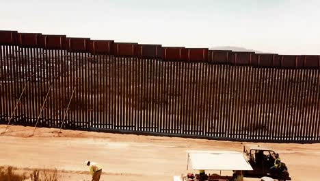 Fly-Over-Of-New-Installed-And-Legacy-Sections-Of-The-Border-Wall-Near-The-Tecate-Port-Of-Entry-In-Tecate-California-June-19-2019