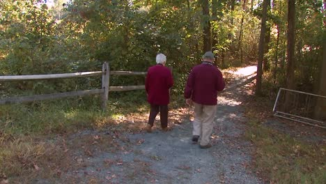 An-Elderly-Couple-Take-A-Boardwalk-Trail-At-The-National-Wildlife-Reserve-Montana-2011