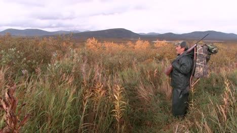 A-Hunter-Tracks-An-Animal-Children-Collect-Wild-Berries-National-Wildlife-Reserve-Montana-2011