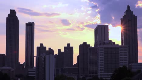 Silhouetted-view-of-skyscrapers-and-high-rises-behind-Atlanta-Georgia-at-sunset