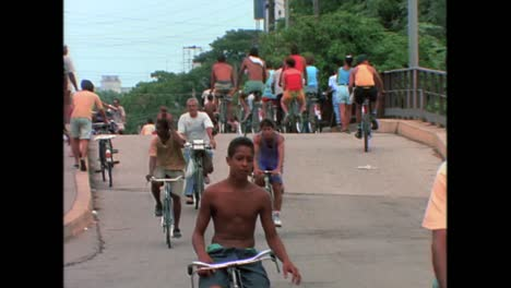 People-ride-bicycles-in-Havana-Cuba-in-the-1980s