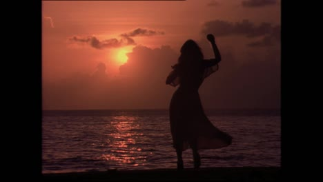 A-sexy-woman-dances-in-front-of-the-sunset-in-a-Latin-American-country-Cuba-in-the-1980s-2