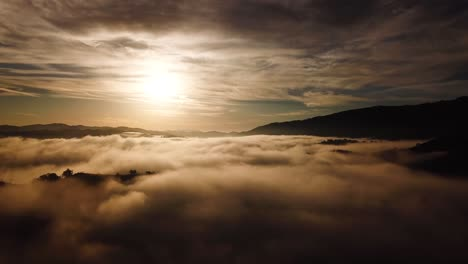 Beautiful-Aerial-Over-A-Foggy-Morning-With-Mountains-And-Clouds-Near-Ojai-California