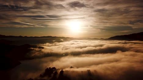 Aerial-Over-Fog-On-A-Golden-Beautiful-Souithern-California-Sunrise-In-The-Region-Of-Ojai-California-1