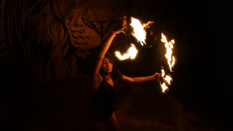 A-Sexy-Mysterious-Female-Fire-Dancer-Performs-A-Dance-In-A-Darkened-Setting-1