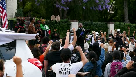 Protesters-Hold-Up-Fists-And-Listen-To-Speaker-During-A-Black-Lives-Matter-Blm-March-In-Los-Angeles-Following-The-George-Floyd-Murder