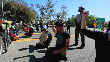 Extreme-Slo-Mo-Protesters-Chanting-And-Standing-Off-With-Police-And-National-Guard-During-A-Black-Lives-Matter-Blm-Parade-In-Ventura-California-2
