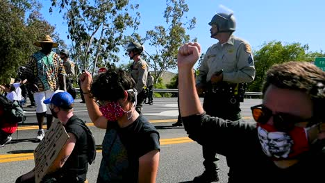 Extreme-Slo-Mo-Protesters-Chanting-And-Standing-Off-With-Police-And-National-Guard-During-A-Black-Lives-Matter-Blm-Parade-In-Ventura-California-3