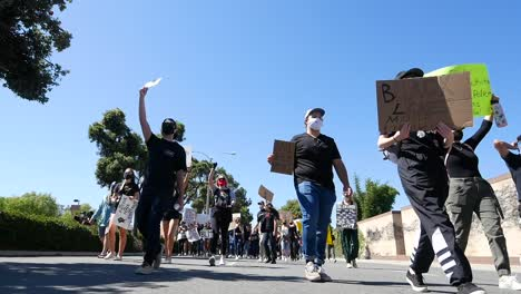 Extreme-Slo-Mo-Marching-Protesters-During-A-Black-Lives-Matter-Blm-March-In-Ventura-California-With-Signs-To-Fund-Schools