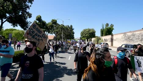 Extreme-Slo-Mo-Marching-Protesters-During-A-Black-Lives-Matter-Blm-March-In-Ventura-California-With-Signs