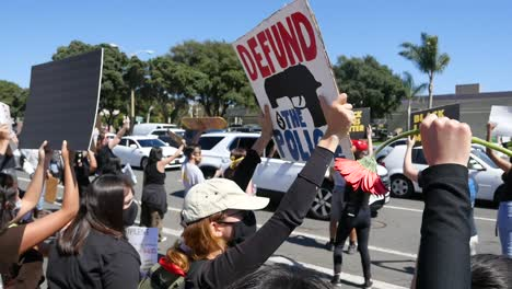 Extreme-Slo-Mo-Signs-Say-Defund-The-Police-During-A-Black-Lives-Matter-Blm-March-In-Ventura-California