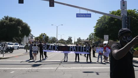 Extreme-Slo-Mo-Protesters-Signs-Says-Black-Lives-Matter-Blm-March-In-Ventura-California