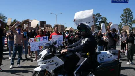 Extreme-Slo-Mo-Motorcycle-Cop-Drives-Past-Protesters-During-A-Black-Lives-Matter-Blm-March-In-Ventura-California