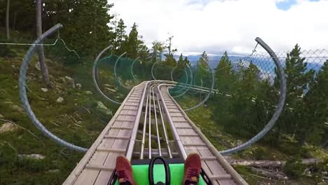 Pov-Of-A-Rider-On-A-Sled-Rollercoaster-Track-On-A-Hillside-In-Andorra-In-This-Action-Adventure-Footage