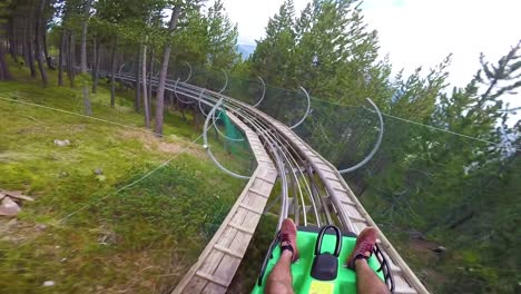 Pov-Of-A-Rider-On-A-Sled-Rollercoaster-Track-On-A-Hillside-In-Andorra-In-This-Action-Adventure-Footage-1
