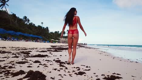 A-Beautiful-Swimsuit-Model-Woman-Walks-On-A-Beach-Resort-In-Barbados-Caribbean