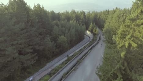 Drone-Aerial-Of-Bikers-Riding-Fast-In-A-Former-Olympic-Bobseld-Track-Near-Sarajevo-Bosnia-1