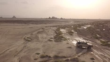 Beautiful-Aerial-Over-Two-4X4-Jeeps-Traveling-Across-The-Deserts-Of-Djibouti-Or-Somalia-2
