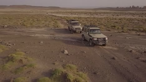 Beautiful-Aerial-Over-Two-4X4-Jeeps-Traveling-Across-The-Deserts-Of-Djibouti-Or-Somalia-3