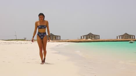 A-Beautiful-Woman-Walks-On-The-Beaches-Of-Somalia-Or-Djibouti-In-Slow-Motion-With-Half-Constructed-Houses-In-The-Background