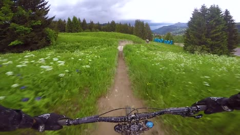 Pov-From-The-Front-Of-A-Bmx-Dirt-Bike-Biking-On-A-Muddy-Outdoor-Course-In-Les-Gets-France-1