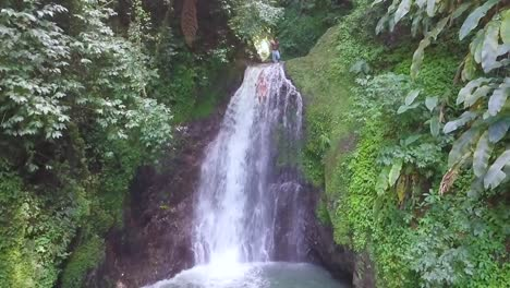 Slow-Motion-Woman-Diving-From-A-Waterfall-Into-A-Pool-In-A-Tropical-Jungle-Grenada-Caribbean