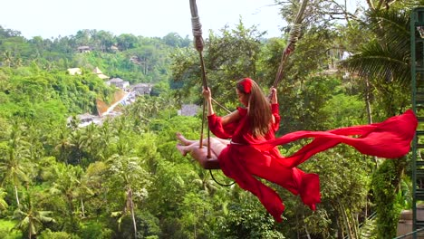 Beautiful-Shot-Of-A-Female-Model-On-A-Swing-With-Rice-Paddies-Of-Bali-Indonesia-In-Background