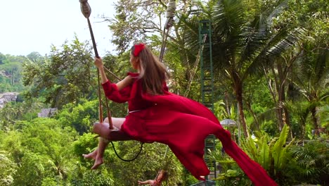 Beautiful-Shot-Of-A-Female-Model-On-A-Swing-With-Rice-Paddies-Of-Bali-Indonesia-In-Background-1