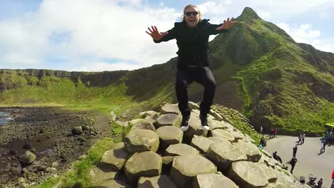 A-Man-Jumps-Up-And-Down-In-Slow-Motion-On-The-Giant-S-Causeway-In-Ireland