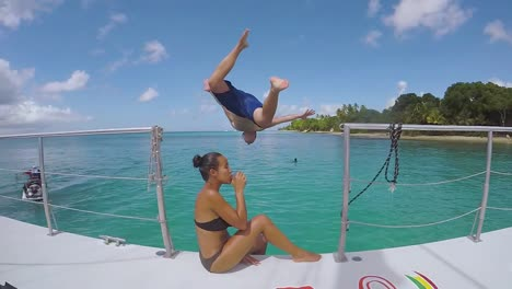 A-Man-Jumps-Off-A-Yacht-Or-Caribbean-Party-Boat-In-Extreme-Slow-Motion