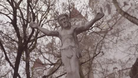 Moving-Shot-Of-A-Lithuanian-Jesus-Christian-Statue-Oustide-A-Cathedral-Church