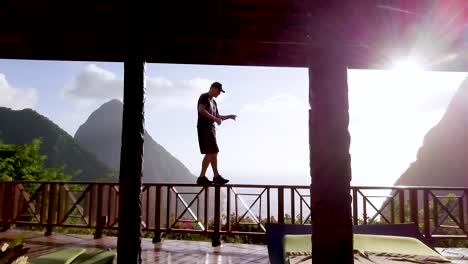 A-Man-Walks-And-Dances-On-A-Balcony-Of-A-Luxury-Hotel-Room-At-St-Lucia-Caribbean