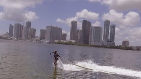 A-Man-Hovers-Using-A-Water-Jetpack-Flyboard-On-The-Ocean-In-Miami-Florida
