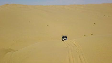 Aerial-Over-4Wd-Safari-Land-Rover-4X4-Driving-Over-Desert-Sand-Dunes-In-The-Namib-Desert-Namibia-Africa