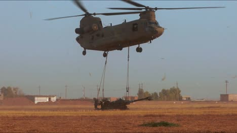 A-Helicopter-Drops-Off-Artillery-Equipment-To-American-Soldiers-Stationed-In-Punjiha-Iraq