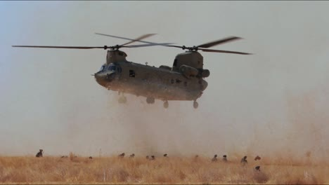 A-Us-Army-Helicopter-Retrieves-Artillery-Equipment-From-A-Field-In-Iraq-And-Takes-Off-With-It