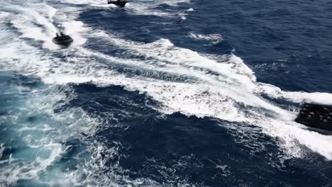 Qatari-Soldiers-Ride-Small-Boats-Alongside-A-Ship-In-The-Red-Sea