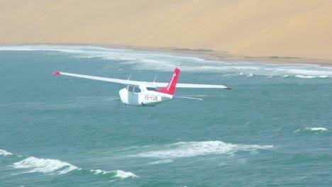 Slow-Motion-Air-To-Air-Shot-Of-A-Light-Plane-Flying-Over-The-Namib-Desert-Skeleton-Coast-Namibia-1