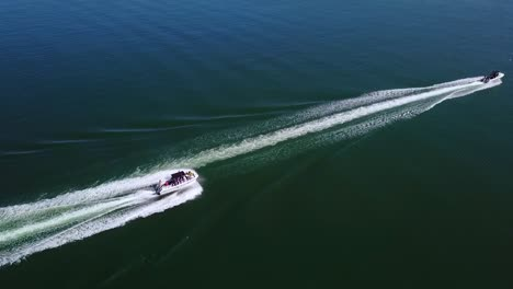 Aerial-Over-Two-Speedboats-Racing-Fast-Across-Blue-Water