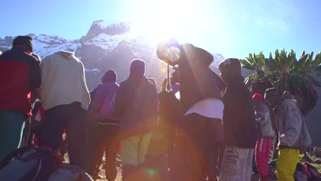 African-Mountain-Guides-And-Porters-Sing-Songs-And-Dance-Before-The-Ascent-Of-Mt-Kilimanjaro