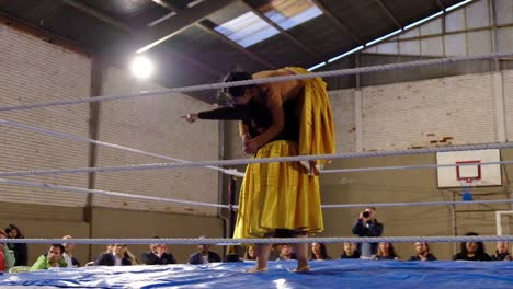 Female-Woman-Cholita-Wrestlers-In-Native-Costume-Fight-In-A-Boxing-Ring-In-Bolivia