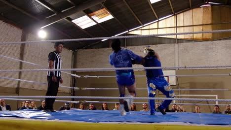 Male-Wrestlers-Fight-In-A-Boxing-Ring-In-Bolivia