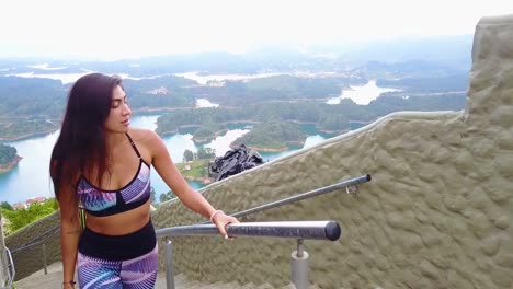 A-Beautiful-Woman-Walks-Up-A-Stairway-On-A-Mountainside-In-Guatepe-Colombia