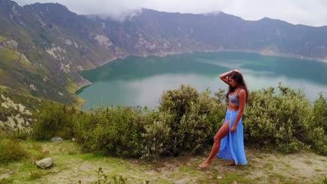 A-Beautiful-Woman-Walks-Along-The-Rim-Of-A-Volcano-And-Cone-At-Quilotoa-Ecuador