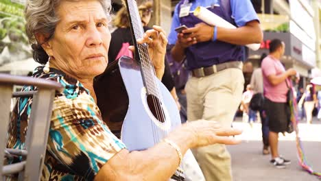 A-Woman-Street-Performer-Plays-The-Guitar-On-The-Street-In-Costa-Rica