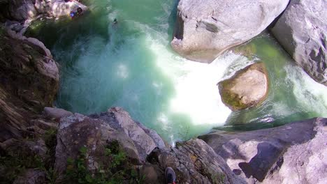 A-Pov-Shot-Of-A-Man-Jumping-Off-A-Cliff-Into-The-La-Ceiba-Waterfall-In-Honduras