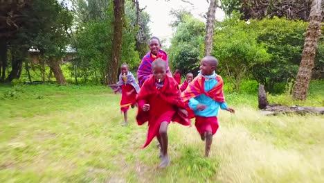 Children-Run-Behind-A-Vehicle-In-Kenya-Africa