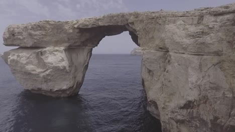 Aerial-Shot-Around-The-Now-Collapsed-Azure-Window-Rock-Formation-On-The-Island-Of-Gozo-In-Malta