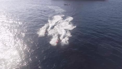 Two-Jet-Skis-Speed-Away-From-A-Very-Large-Yacht-On-The-Ocean-Near-Malta